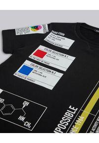 DSQUARED2 KIDS - Czarna sukienka z grafikami 12-16 lat. Okazja: na co dzień. Kolor: czarny. Wzór: aplikacja, kolorowy. Sezon: lato. Typ sukienki: proste. Styl: klasyczny, casual