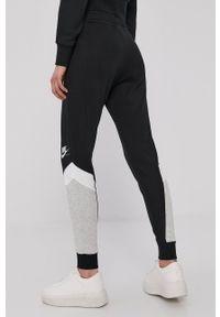 Nike Sportswear - Spodnie. Kolor: czarny. Materiał: dzianina