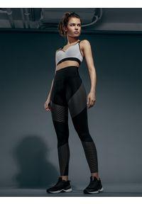 Czarne legginsy 4f z podwyższonym stanem