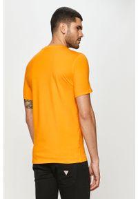 Pomarańczowy t-shirt Guess Jeans z nadrukiem