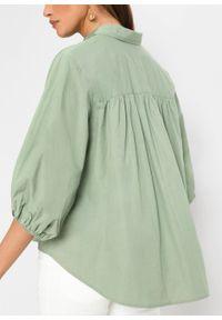 Bluzka oversize bonprix dymny zielony. Kolor: zielony