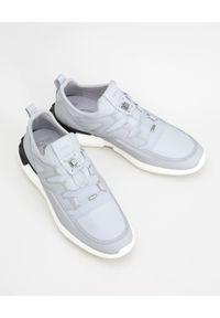 TOD'S - Białe sneakersy No Code 03. Nosek buta: okrągły. Kolor: szary. Materiał: neopren, guma. Wzór: aplikacja