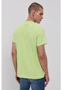 Tommy Jeans - T-shirt. Okazja: na co dzień. Kolor: zielony. Materiał: bawełna, dzianina. Wzór: gładki, aplikacja. Styl: casual