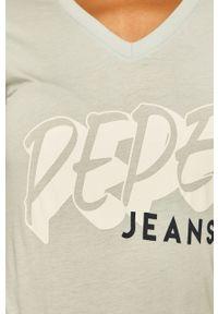Niebieska bluzka Pepe Jeans na co dzień, z aplikacjami, casualowa