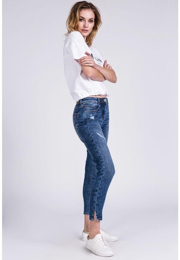Niebieskie spodnie Monnari z nadrukiem