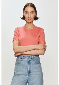 Różowa bluzka Lacoste na co dzień, casualowa
