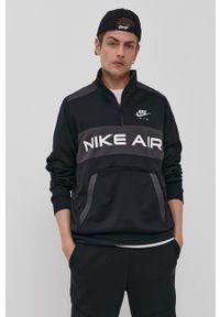 Nike Sportswear - Bluza. Okazja: na co dzień. Kolor: czarny. Materiał: materiał. Długość: krótkie. Wzór: gładki, nadruk. Styl: casual