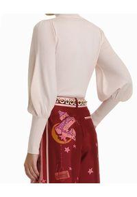 ZIMMERMANN - Beżowy sweter z golfem. Typ kołnierza: golf. Kolor: beżowy. Materiał: wełna. Długość rękawa: długi rękaw. Długość: długie