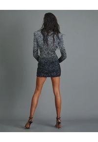 RETROFETE - Dwukolorowa sukienka Nikki. Okazja: na imprezę. Kolor: czarny. Wzór: haft. Styl: elegancki