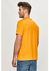 Champion - T-shirt. Okazja: na co dzień. Kolor: pomarańczowy. Materiał: dzianina. Wzór: gładki. Styl: casual