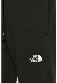 Czarne spodnie dresowe The North Face #4