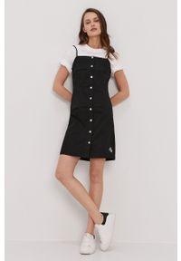 Calvin Klein Jeans - Sukienka. Kolor: czarny. Materiał: tkanina. Długość rękawa: na ramiączkach. Wzór: gładki. Typ sukienki: dopasowane