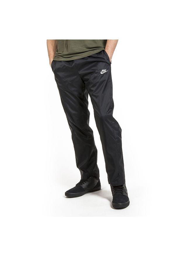 Czarne spodnie Nike z aplikacjami, długie