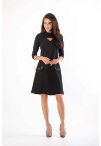 Czarna sukienka wizytowa Nommo ze stójką, prosta