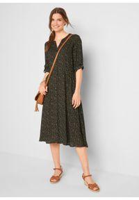 Sukienka midi z nadrukiem bonprix czarny wzorzysty. Typ kołnierza: dekolt w serek. Kolor: czarny. Wzór: nadruk. Długość: midi