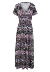 Długa sukienka z dżerseju z krótkim rękawem bonprix czarno-lila w kwiaty. Kolor: czarny. Materiał: jersey. Długość rękawa: krótki rękaw. Wzór: kwiaty. Długość: maxi