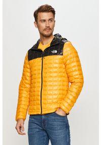 Żółta kurtka The North Face z kapturem
