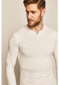 Biała koszulka z długim rękawem medicine