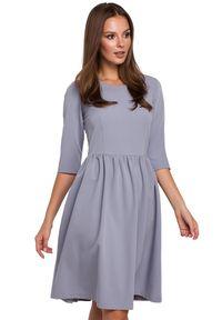 Makover - Rozkloszowana sukienka midi klasyczny fason. Okazja: do pracy, na randkę. Typ sukienki: rozkloszowane. Styl: klasyczny. Długość: midi