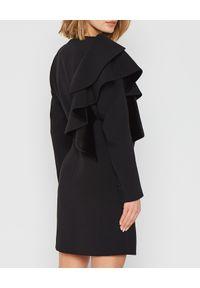 MARLU - Czarna sukienka marynarkowa z falbaną. Kolor: czarny. Materiał: materiał. Wzór: gładki. Typ sukienki: dopasowane. Styl: wizytowy. Długość: mini