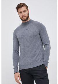 Calvin Klein - Sweter wełniany. Okazja: na co dzień. Kolor: szary. Materiał: wełna. Długość rękawa: raglanowy rękaw. Styl: casual