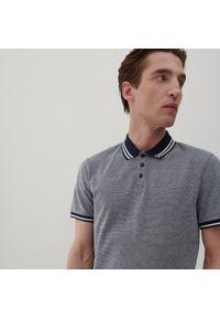 Reserved - Koszulka polo z dzianiny pique - Granatowy. Typ kołnierza: polo. Kolor: niebieski. Materiał: dzianina