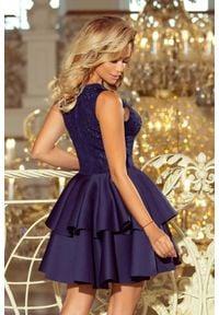 Numoco - Koktajlowa sukienka z haftem i podwójną falbaną. Materiał: elastan. Wzór: haft. Styl: wizytowy