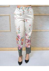 CRISTINAEFFE - Spodnie w kwiatowy print. Kolor: beżowy. Wzór: kwiaty, nadruk. Sezon: wiosna. Styl: klasyczny