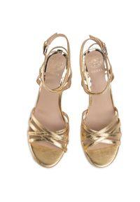 Złote sandały Guess eleganckie