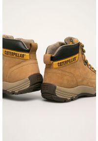 Żółte buty trekkingowe CATerpillar na sznurówki, z cholewką