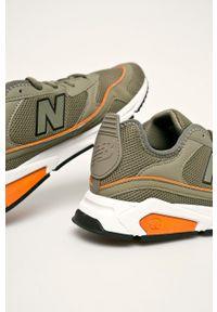 Zielone sneakersy New Balance na sznurówki, z cholewką