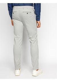 TOMMY HILFIGER - Tommy Hilfiger Tailored Spodnie materiałowe Flex Fks Washed TT0TT06987 Szary Slim Fit. Kolor: szary. Materiał: materiał