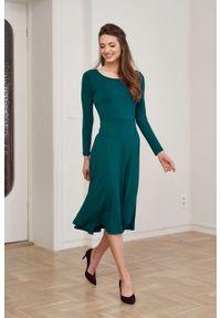 Marie Zélie - Sukienka Margarita szmaragdowa. Kolor: zielony. Materiał: wiskoza, dzianina, materiał, elastan, tkanina. Długość rękawa: długi rękaw. Typ sukienki: trapezowe