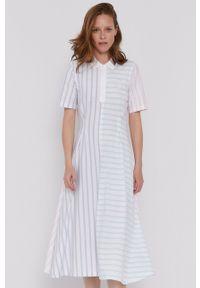 TOMMY HILFIGER - Tommy Hilfiger - Sukienka. Kolor: biały. Materiał: dzianina, bawełna. Długość rękawa: krótki rękaw. Wzór: aplikacja. Typ sukienki: rozkloszowane
