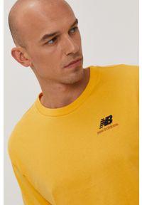 New Balance - T-shirt. Kolor: żółty. Materiał: dzianina