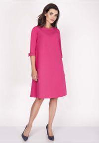 Różowa sukienka Nommo z kokardą, mini, trapezowa