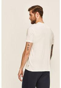 Biała bluzka Russell Athletic z nadrukiem, casualowa, z okrągłym kołnierzem
