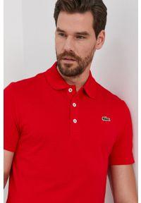 Lacoste - Polo. Typ kołnierza: polo. Kolor: czerwony. Materiał: dzianina. Długość: krótkie. Wzór: gładki