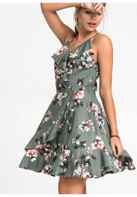 Sukienka z falbanami bonprix zielony eukaliptusowy w kwiaty. Typ kołnierza: dekolt w serek. Kolor: zielony. Wzór: kwiaty