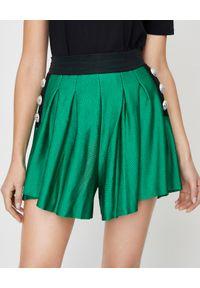 Balmain - BALMAIN - Zielone spodenki z guzikami. Okazja: na co dzień. Kolor: zielony. Materiał: materiał. Wzór: aplikacja. Styl: elegancki, casual