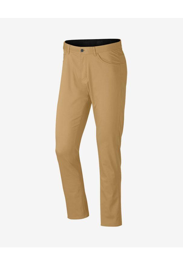 Brązowe spodnie Nike w kolorowe wzory