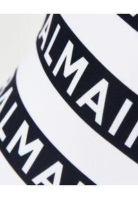 Balmain - BALMAIN - Strój jednoczęściowy z logo. Kolor: czarny. Wzór: paski