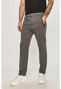 Calvin Klein - Spodnie. Okazja: na co dzień. Kolor: szary. Styl: casual