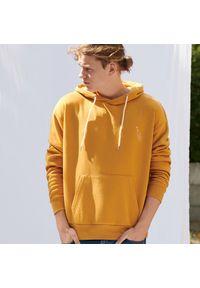 Żółta bluza Sinsay z kapturem