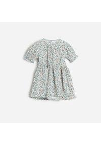 Turkusowa sukienka Reserved w kwiaty