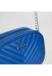 Wittchen - Damska listonoszka z ukośnym pikowaniem. Kolor: niebieski. Materiał: skórzane. Styl: casual