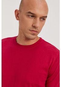Calvin Klein Jeans - T-shirt. Okazja: na co dzień. Kolor: różowy. Materiał: bawełna, dzianina. Wzór: gładki, aplikacja. Styl: casual