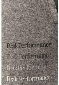 Szare spodnie dresowe Peak Performance z nadrukiem