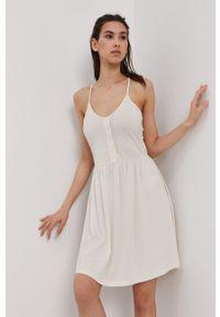 Vero Moda - Sukienka. Kolor: beżowy. Materiał: bawełna, dzianina. Długość rękawa: na ramiączkach. Wzór: gładki. Typ sukienki: rozkloszowane