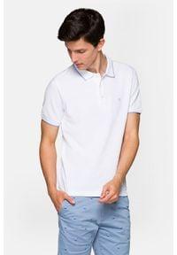 Lancerto - Koszulka Biała Polo Dominic. Typ kołnierza: polo. Kolor: biały. Materiał: materiał, tkanina, bawełna, włókno. Długość rękawa: krótki rękaw. Wzór: ze splotem. Styl: klasyczny